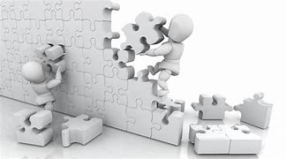 black and white pic of a puzzle being build